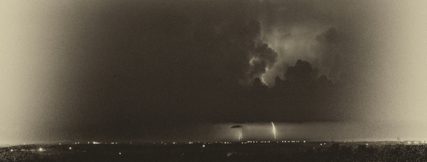 Sepia Image of Storm Over A City